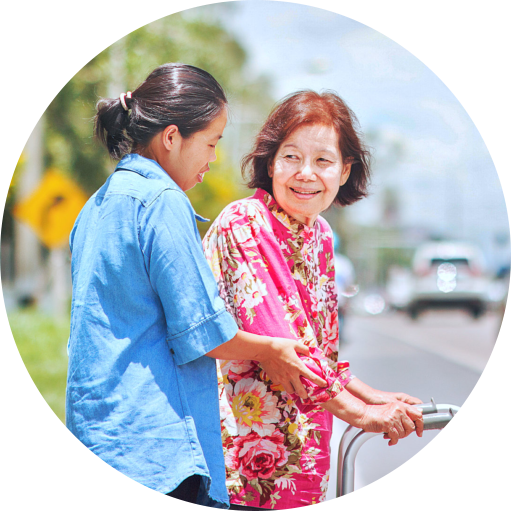caregiver helping senior woman to cross on road