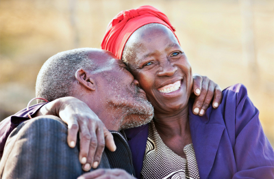 sweet african american couple hugging and kissing
